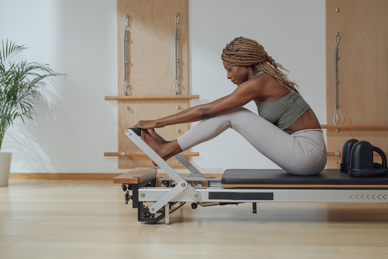 beautiful black woman over 40 doing pilates
