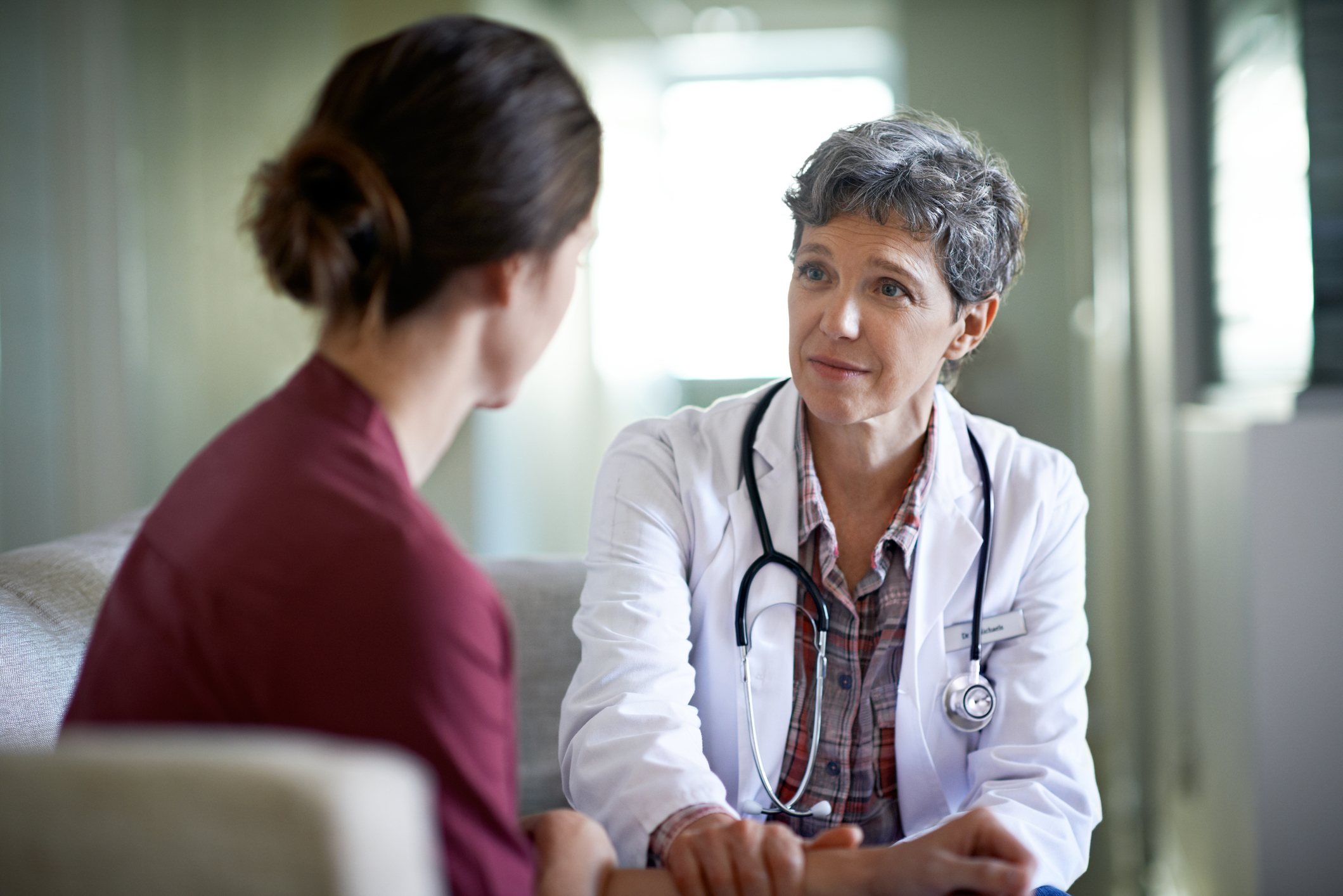 doctor explaining to a patient about surgical menopause